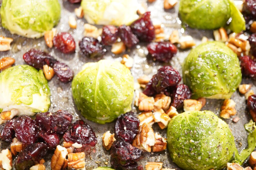 Roasted Brussel sprouts topped with cranberries and bacon
